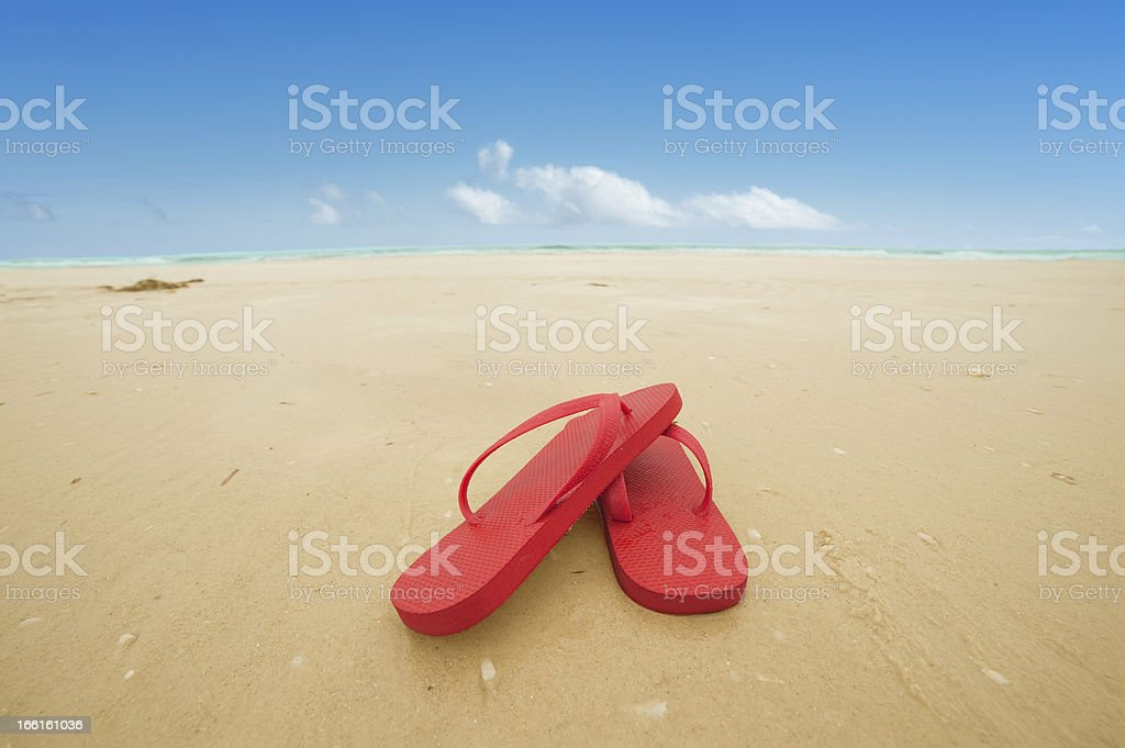 Red flip flops on the beach royalty-free stock photo