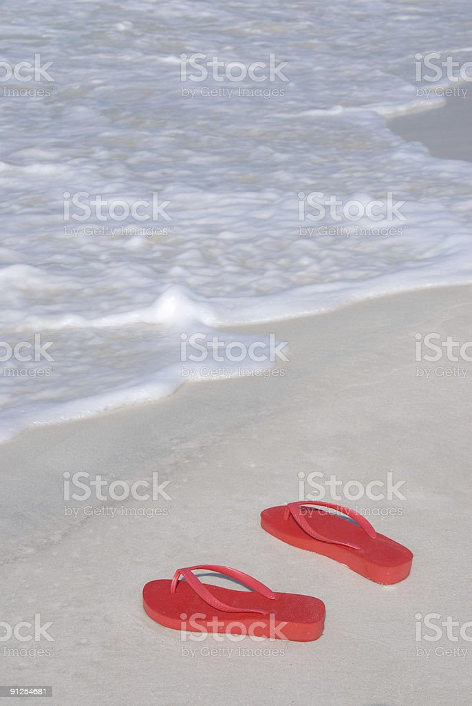 Red Flip-flops on the beach royalty-free stock photo