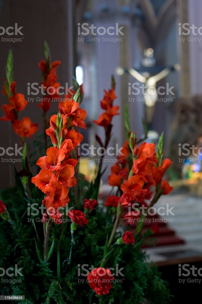 Red Flowers in Cathedral-vertical stock photo