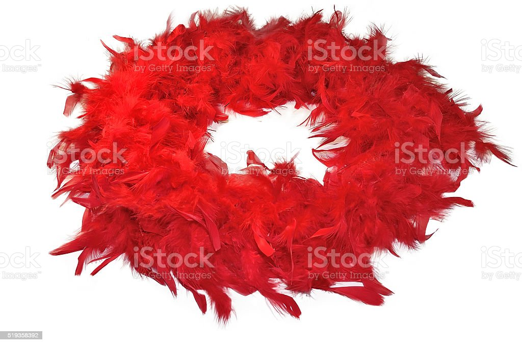 Red fluffy feather boa isolated on white background stock photo