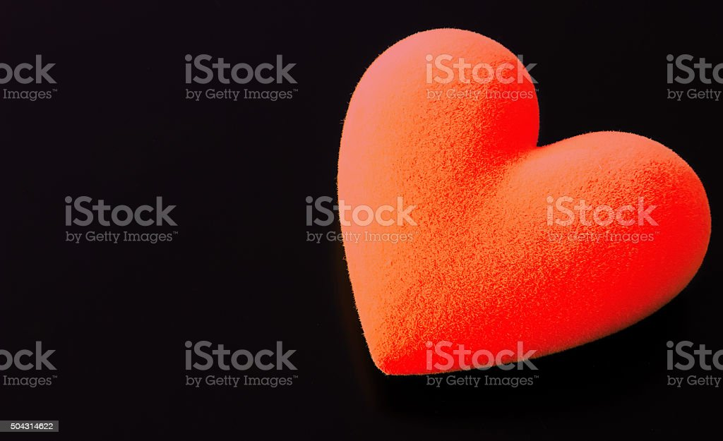 Red fluffy heart on a black background stock photo