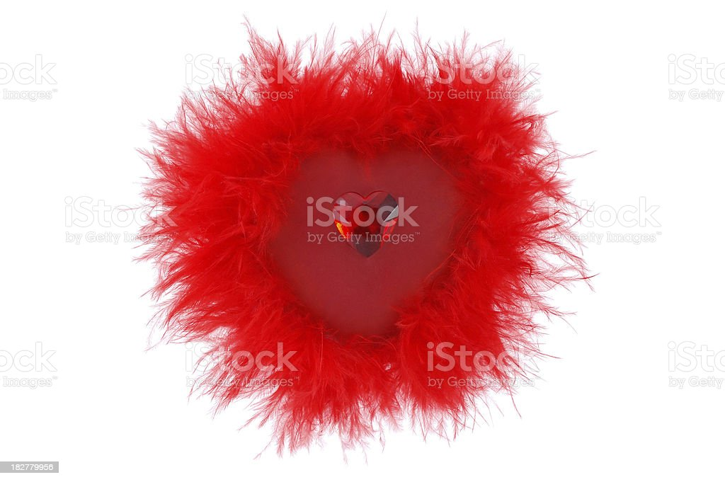 Red fluffy heart with a ruby. Isolated on white stock photo