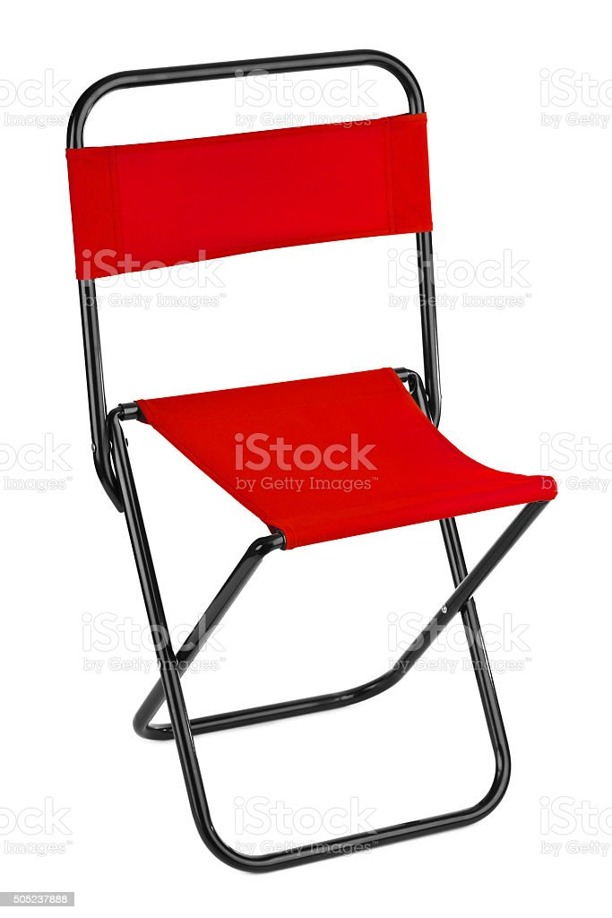 Red folding chair stock photo