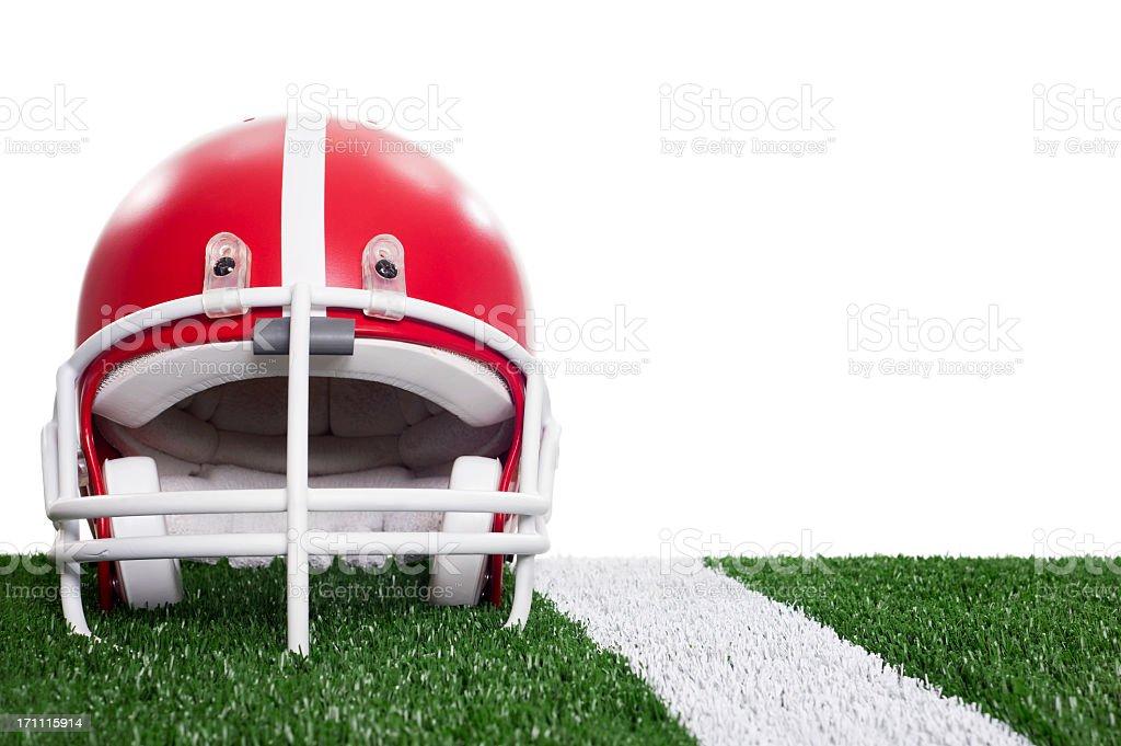 Red Football Helmet On Artificial Turf Near Yard Line royalty-free stock photo