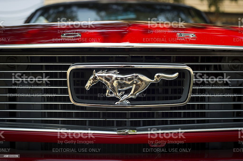 Red Ford Mustang logo on front car stock photo