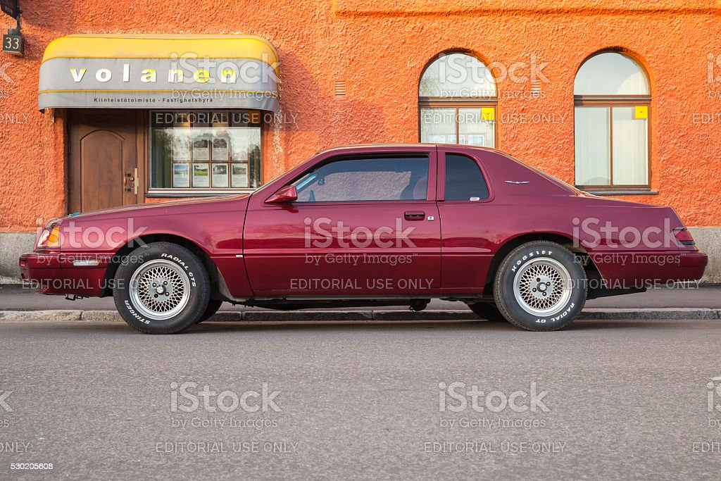 Red Ford Thunderbird ninth generation, side stock photo