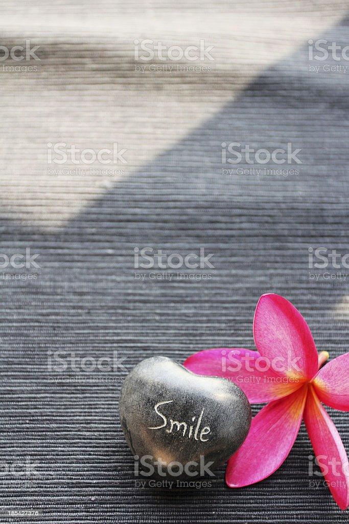 Red Frangipani and a heart-shape stone royalty-free stock photo