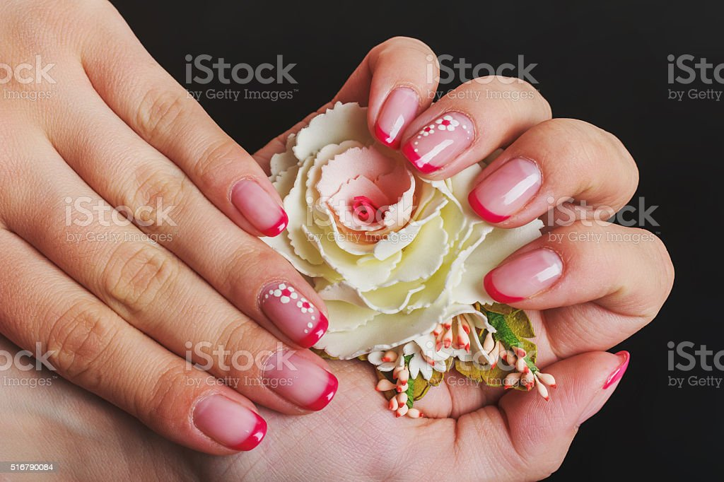 Red french nail art with flower stock photo