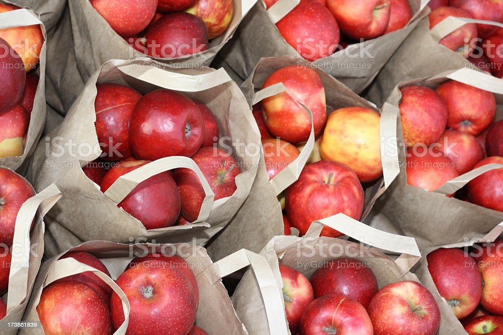 red fresh apples in paperbags, background royalty-free stock photo