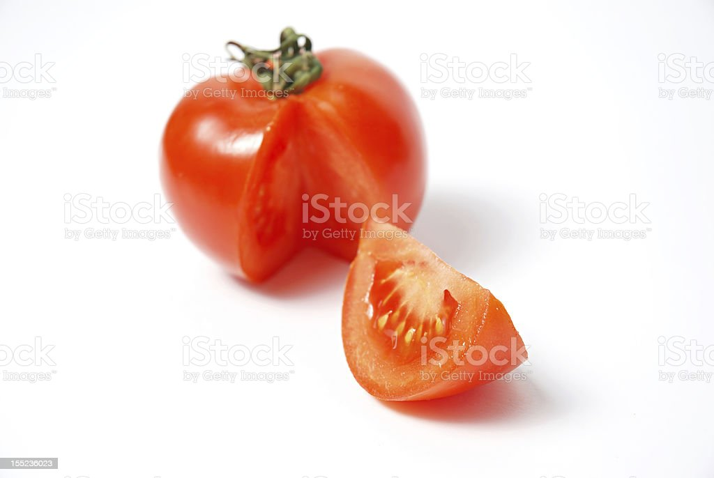 Red fresh tomato whit a slice royalty-free stock photo