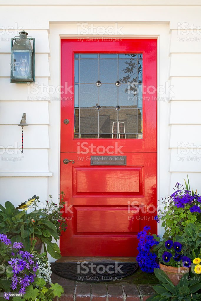 Red front door of a home stock photo
