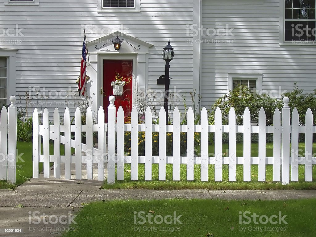Red Front Door on Colonial Style House stock photo