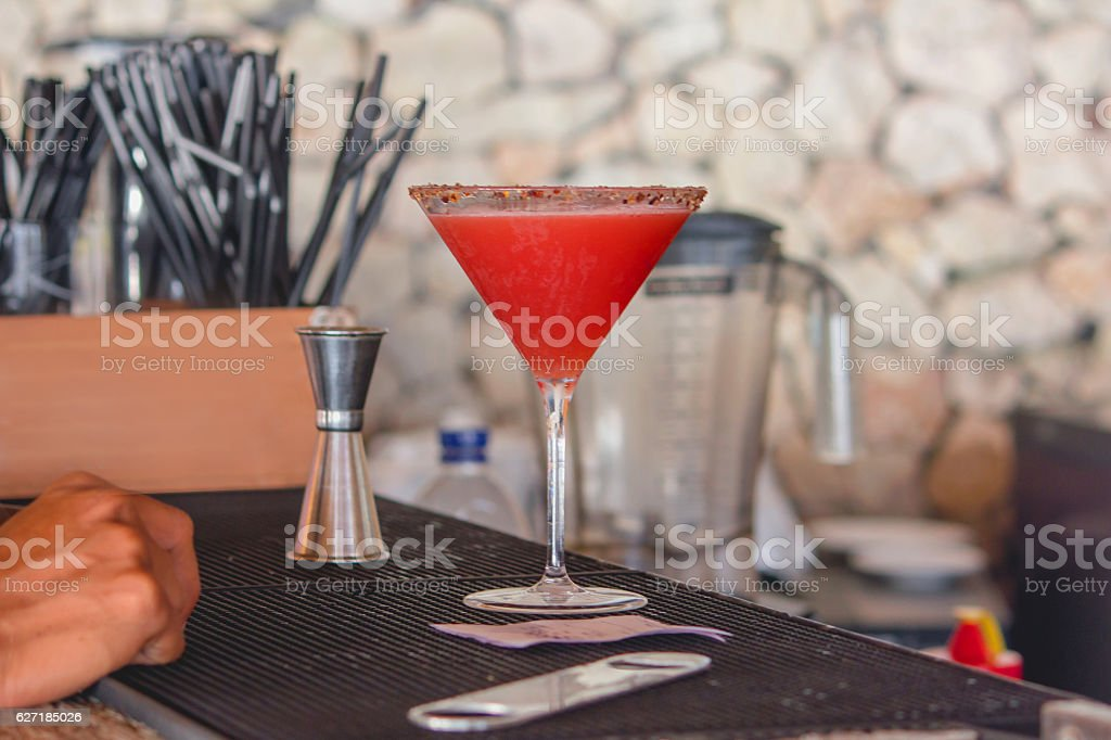 Red fruity cocktail on the bar stock photo