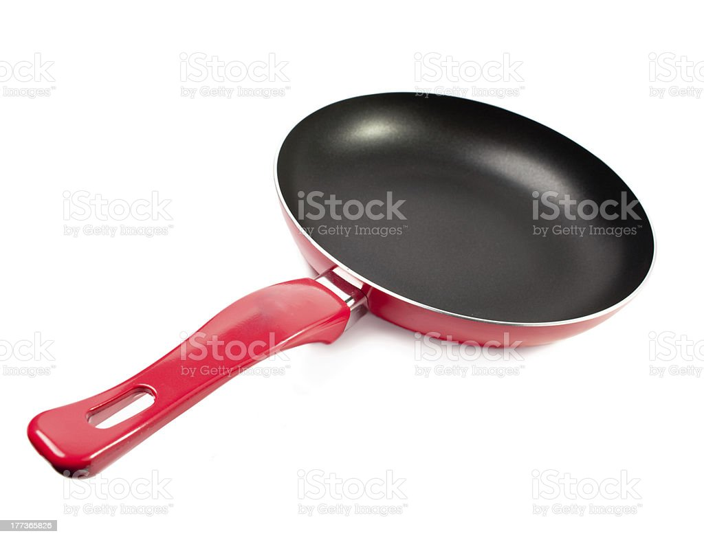Red frying pan with a nonstick coating stock photo