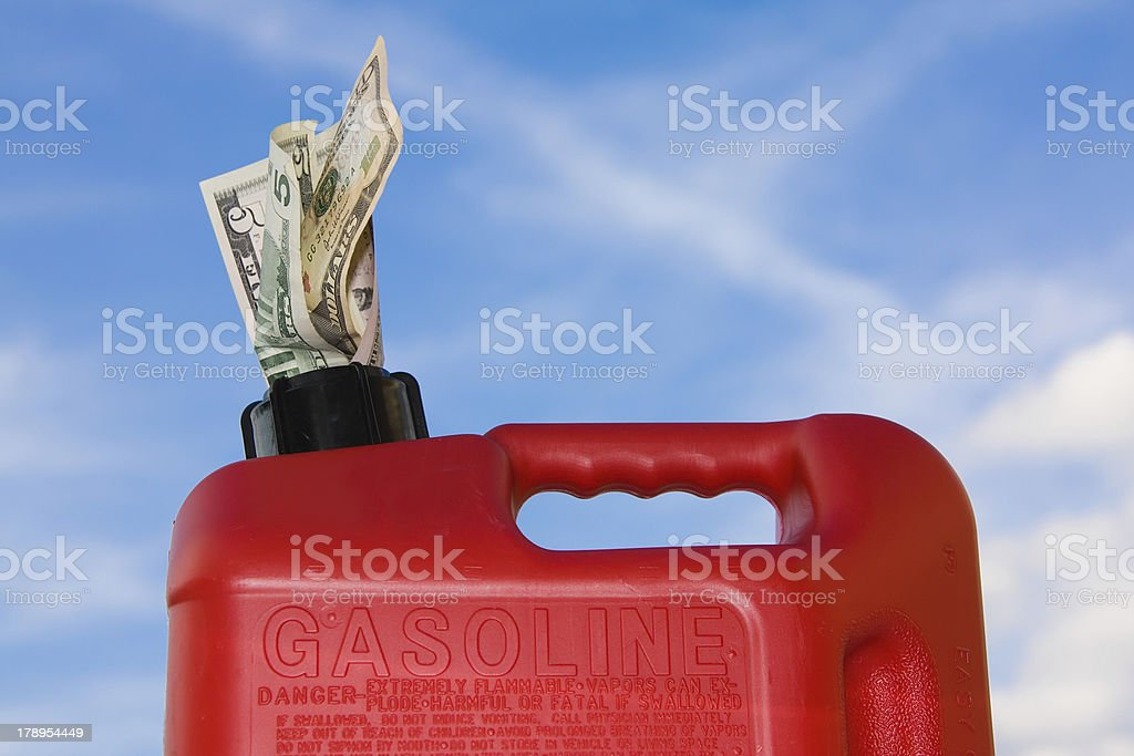 Red Fuel Container with Dollar Bills Sticking Out royalty-free stock photo