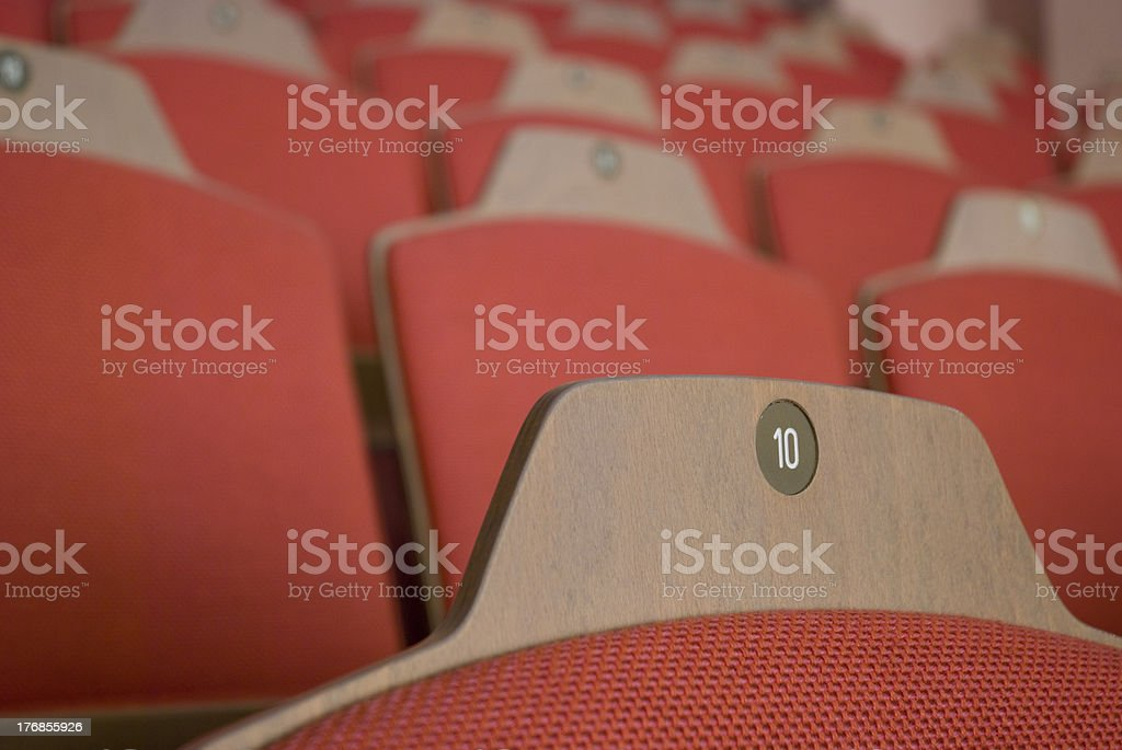 Red furniture in theatre with numbers royalty-free stock photo