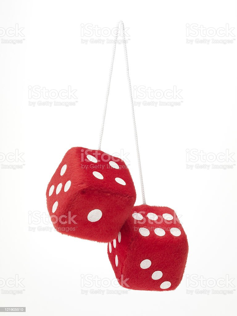 Red fuzzy dice isolated on a white background stock photo