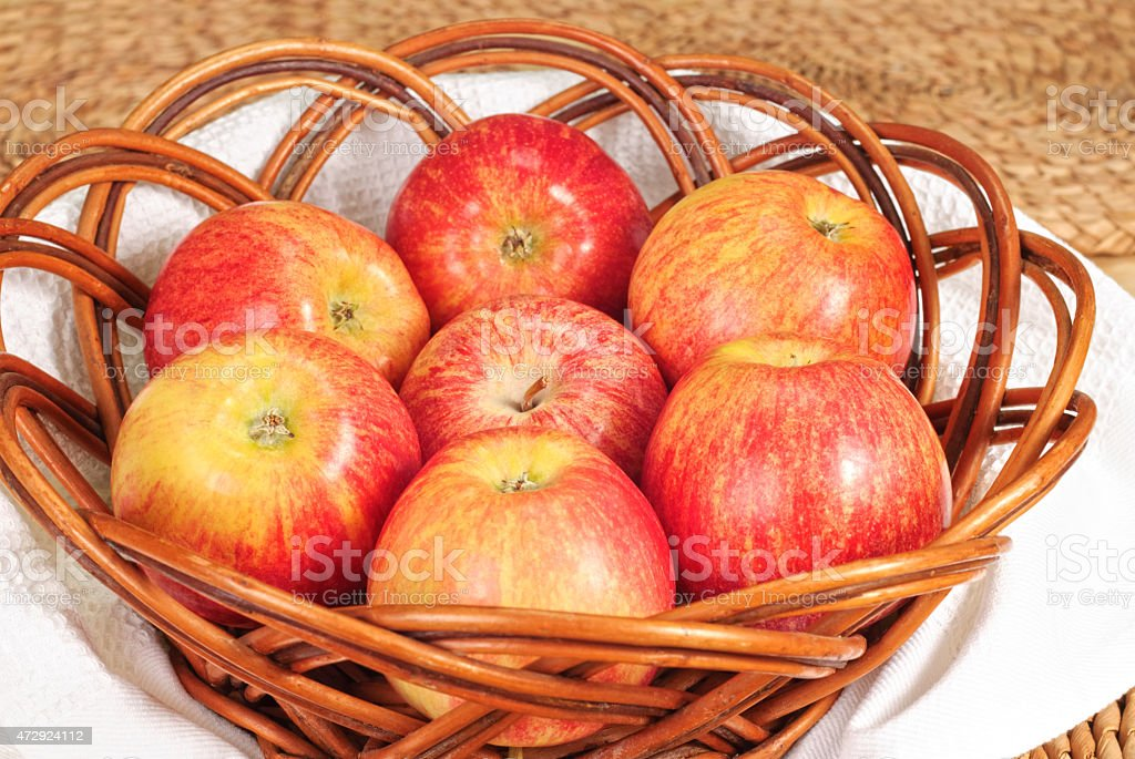 Red Gala apples in a wicker plate stock photo