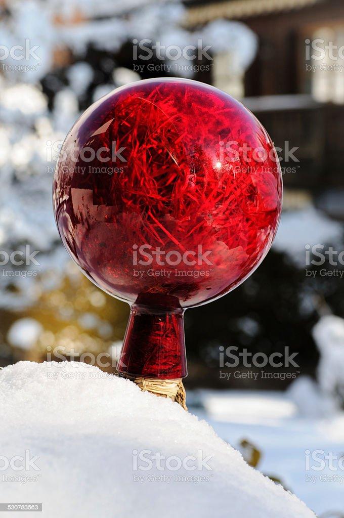 red garden ball stock photo