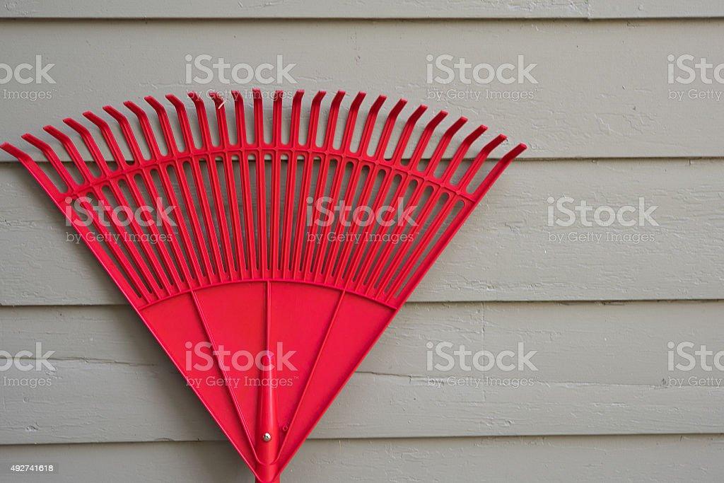 Red Garden Rake stock photo