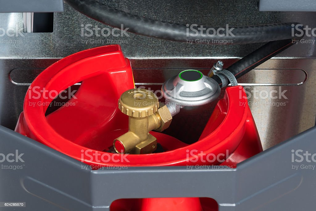 red gas tank in the heater stock photo