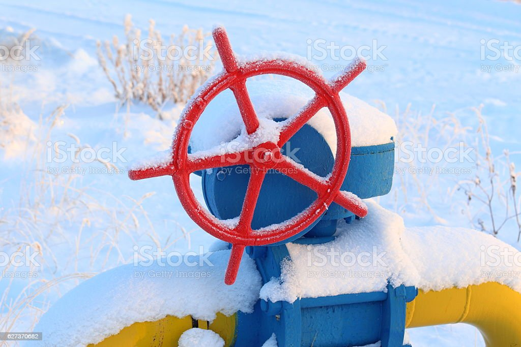 Red gas valve in the winter stock photo