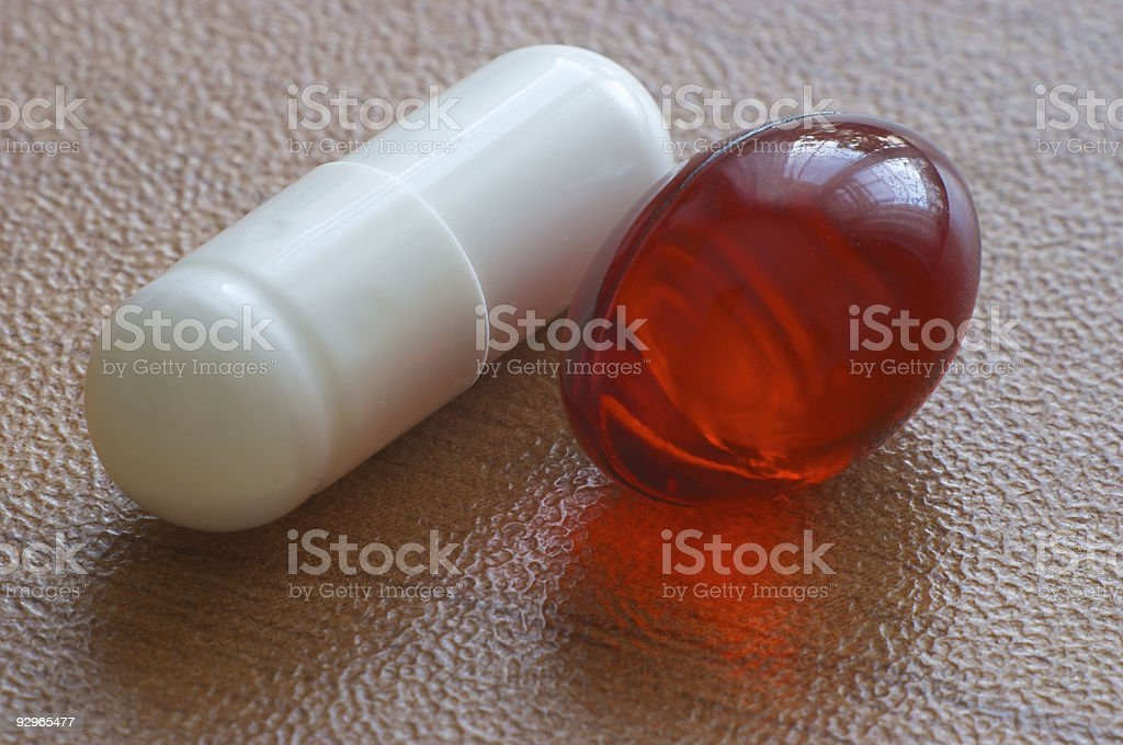 Red gelatine pill and capsule stock photo