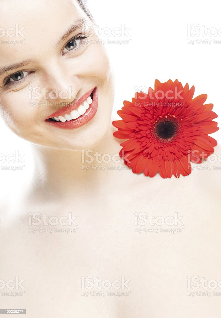 Red gerbera daisy and face of woman royalty-free stock photo