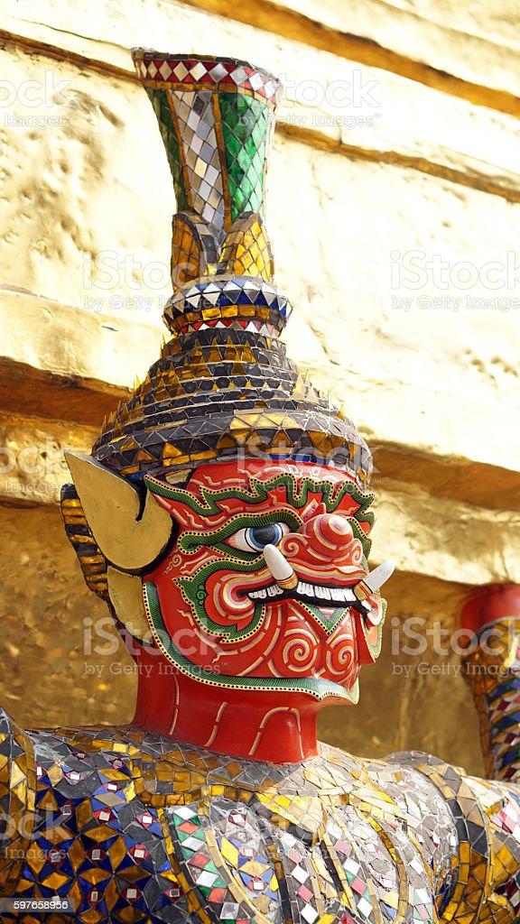 Red giant statue Wat Phra Kaew Temple Of Emerald Buddha. stock photo