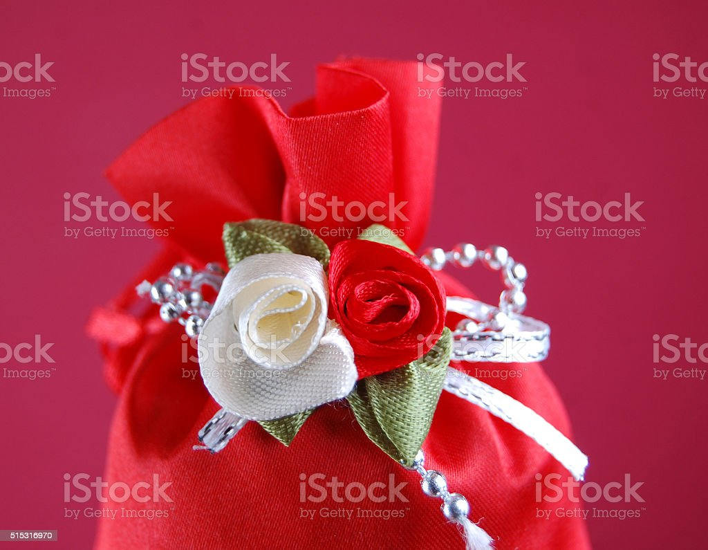 red gift bag with flowers stock photo