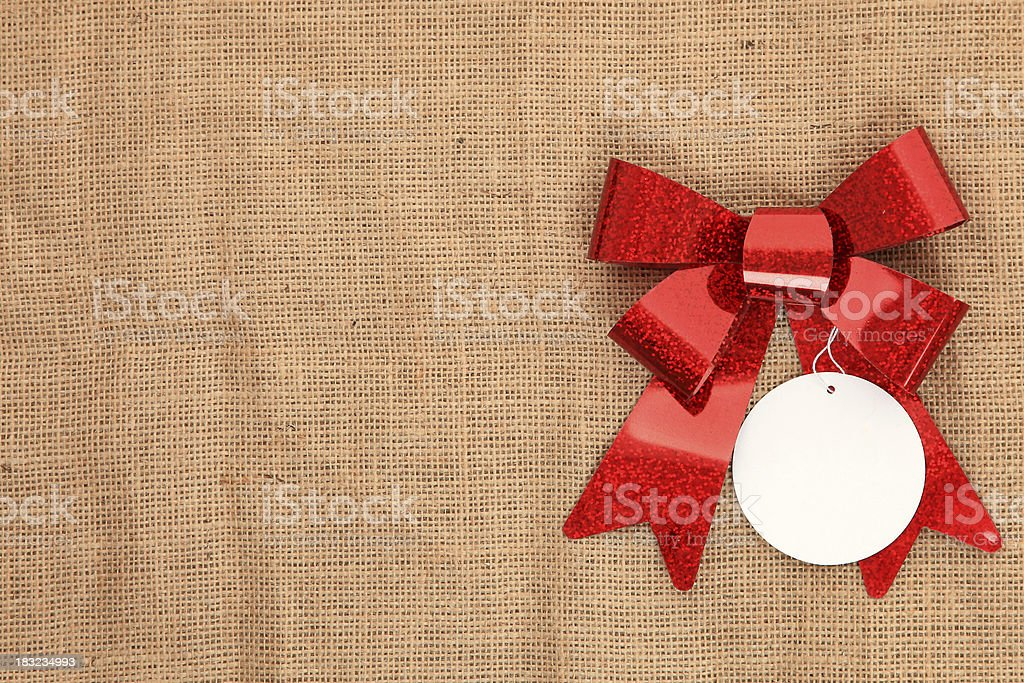 Red gift bow with blank label royalty-free stock photo