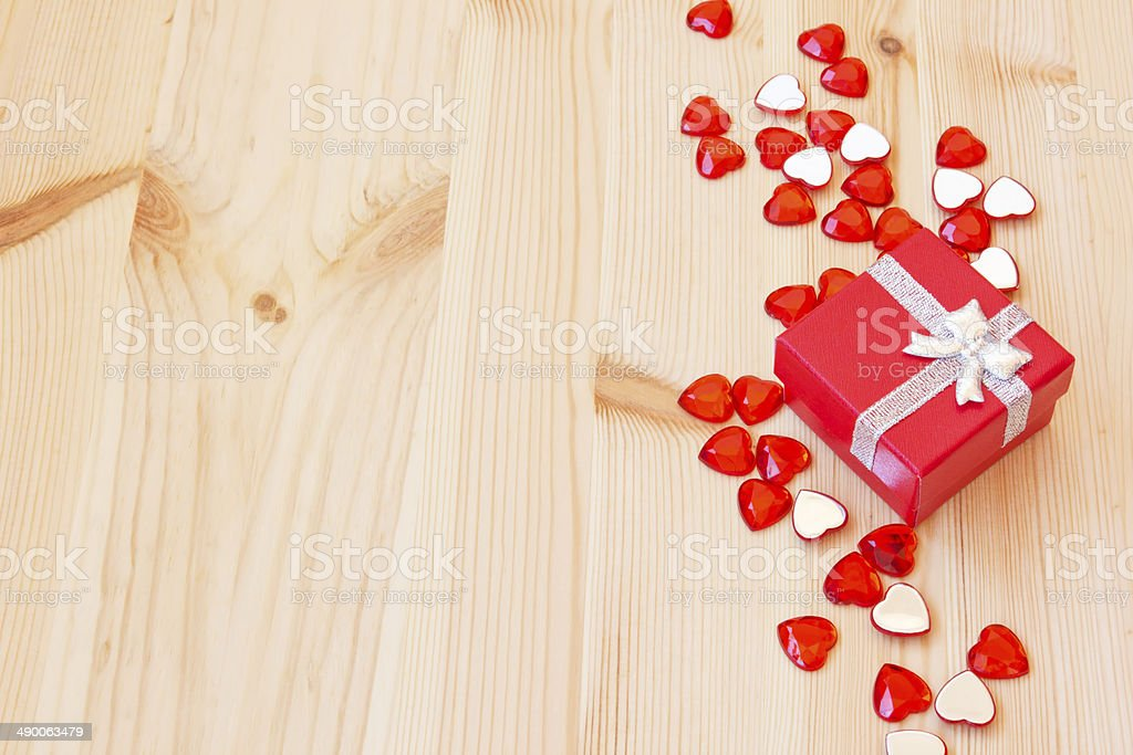 red gift box and small valentine's hearts royalty-free stock photo