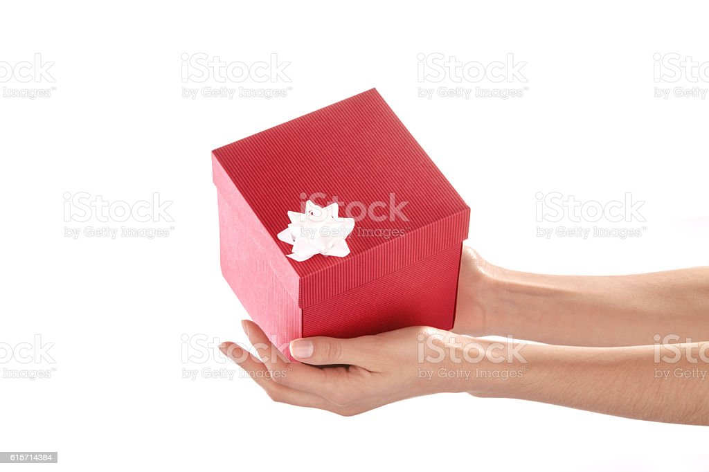 Red gift box in palms stock photo