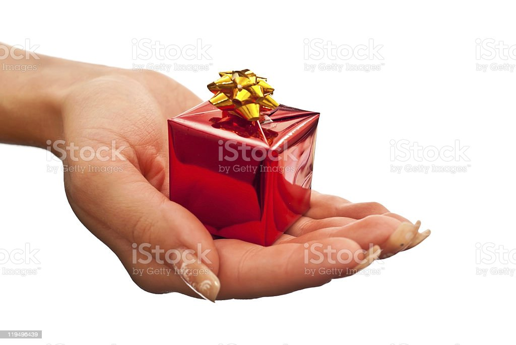 Red gift box in woman's hand royalty-free stock photo
