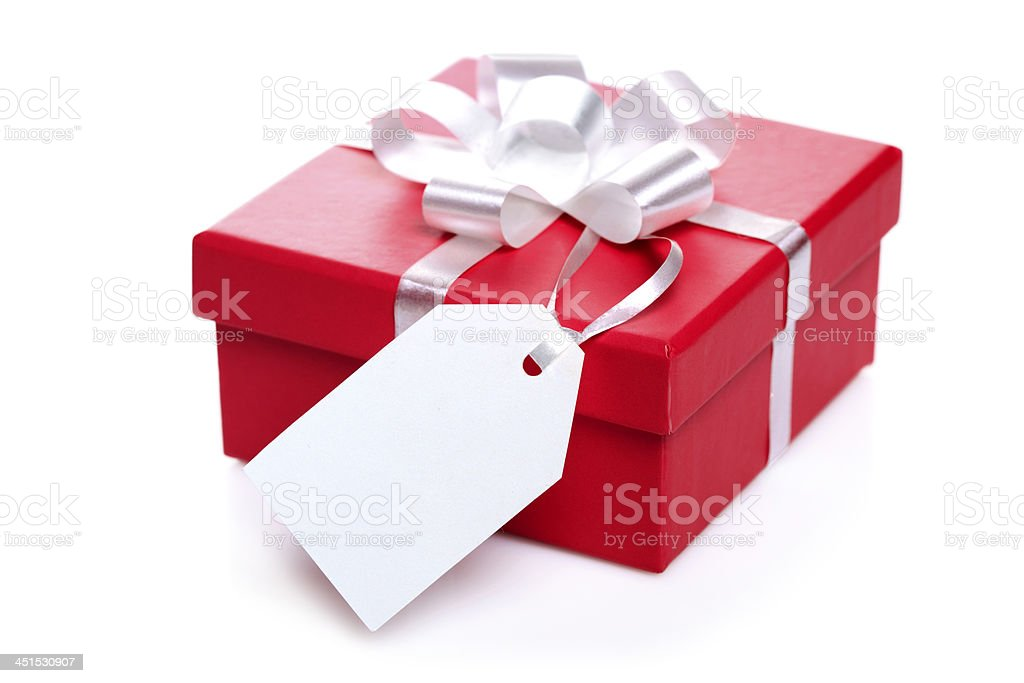 A red gift box with a white ribbon and tag stock photo