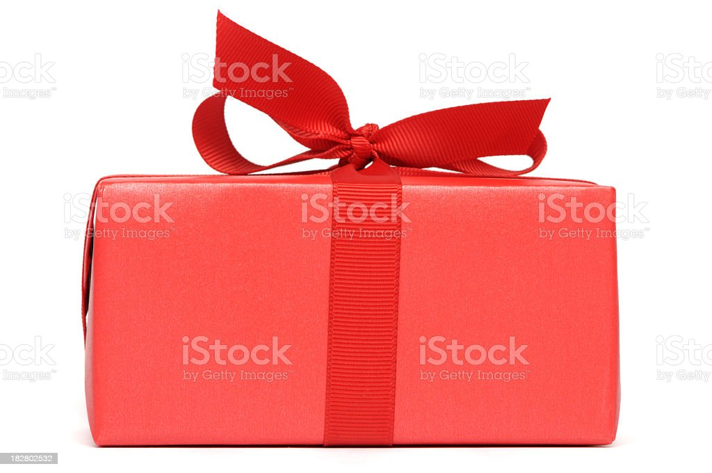 A red gift box with red ribbon stock photo