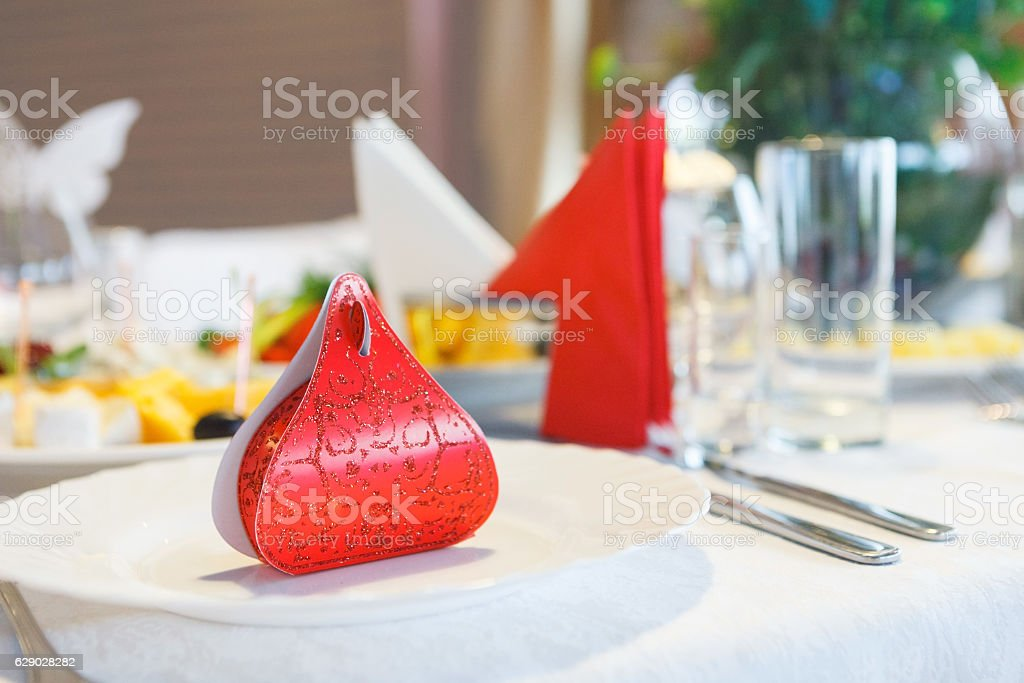 Red Gift box with surprise on plate