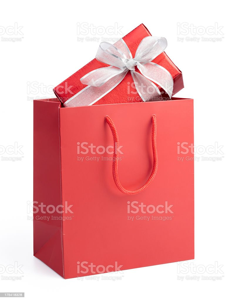 Red gift box with white bow ribbon in a red gift bag stock photo