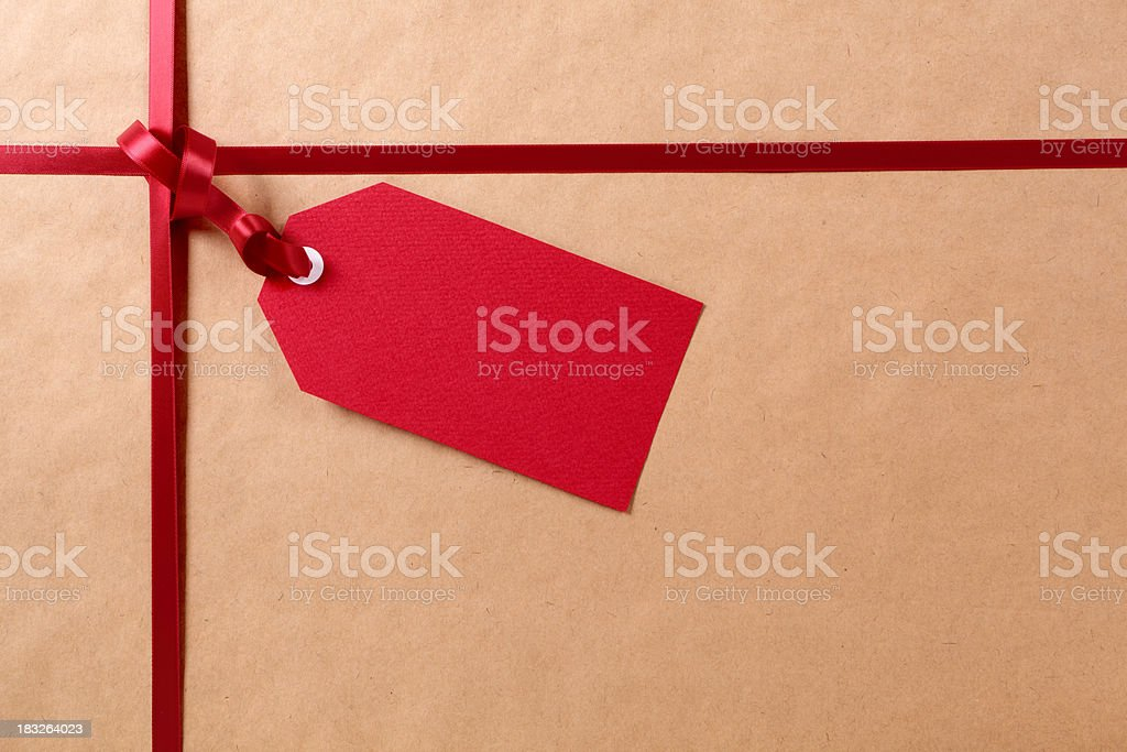 Red gift tag and package. stock photo