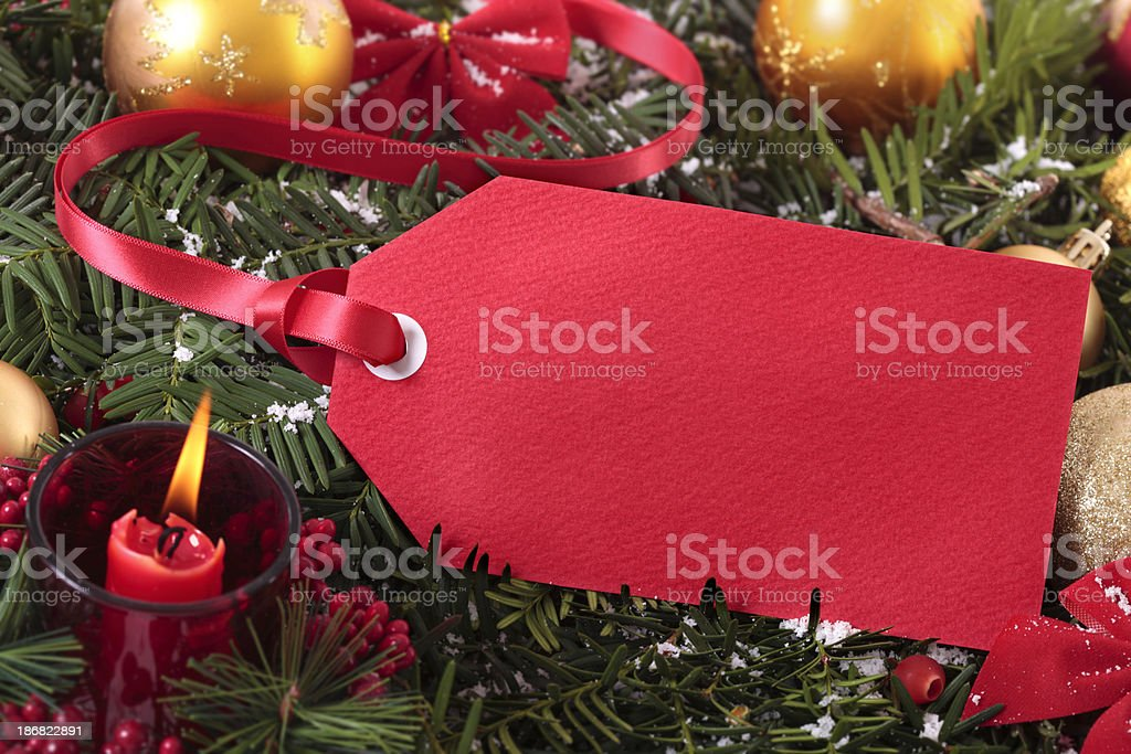 Red gift tag with decorations royalty-free stock photo