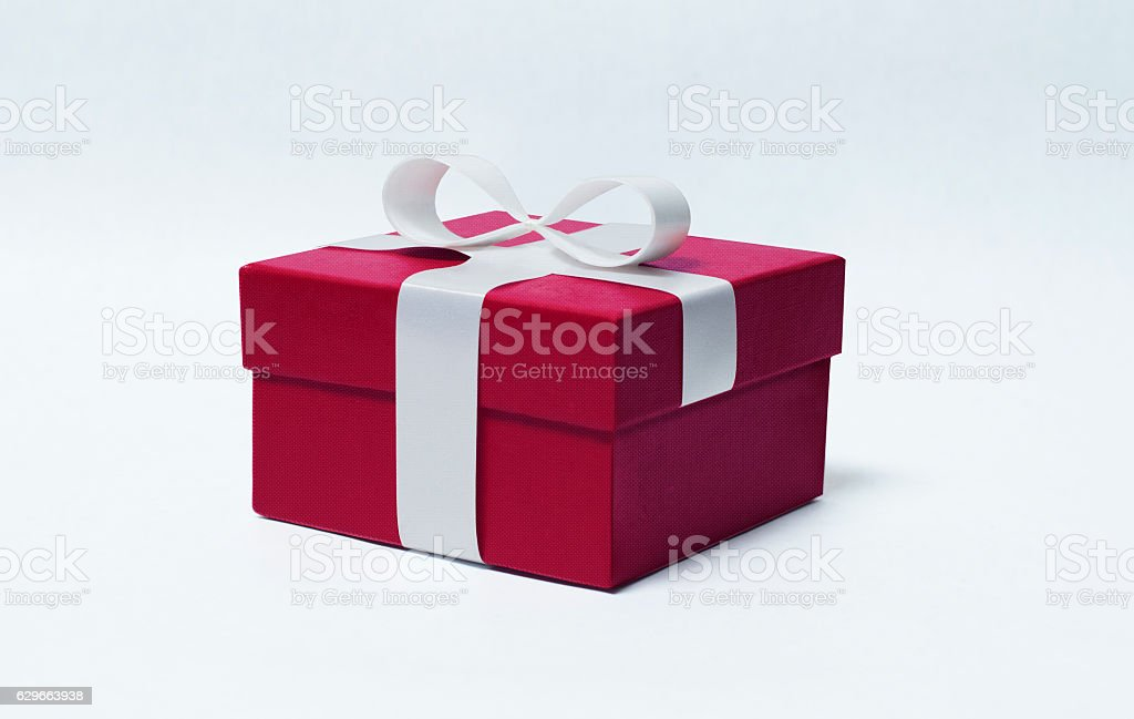 Red gift with white ribbon stock photo