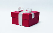 Red gift with white ribbon