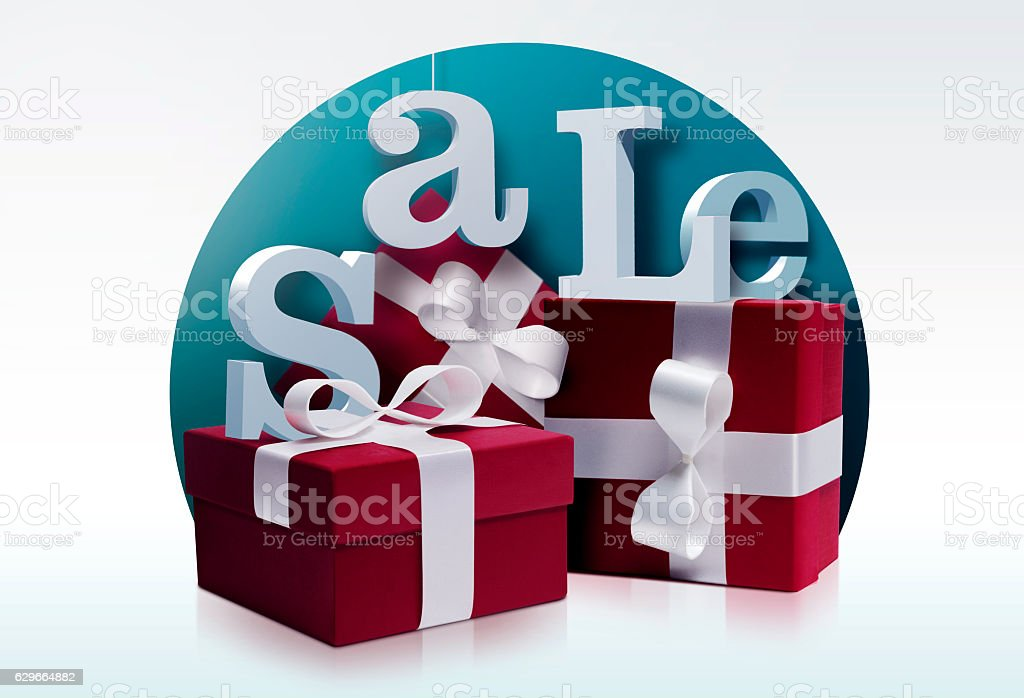 Red gifts with white ribbon and sale letters stock photo