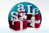 Red gifts with white ribbon and sale letters