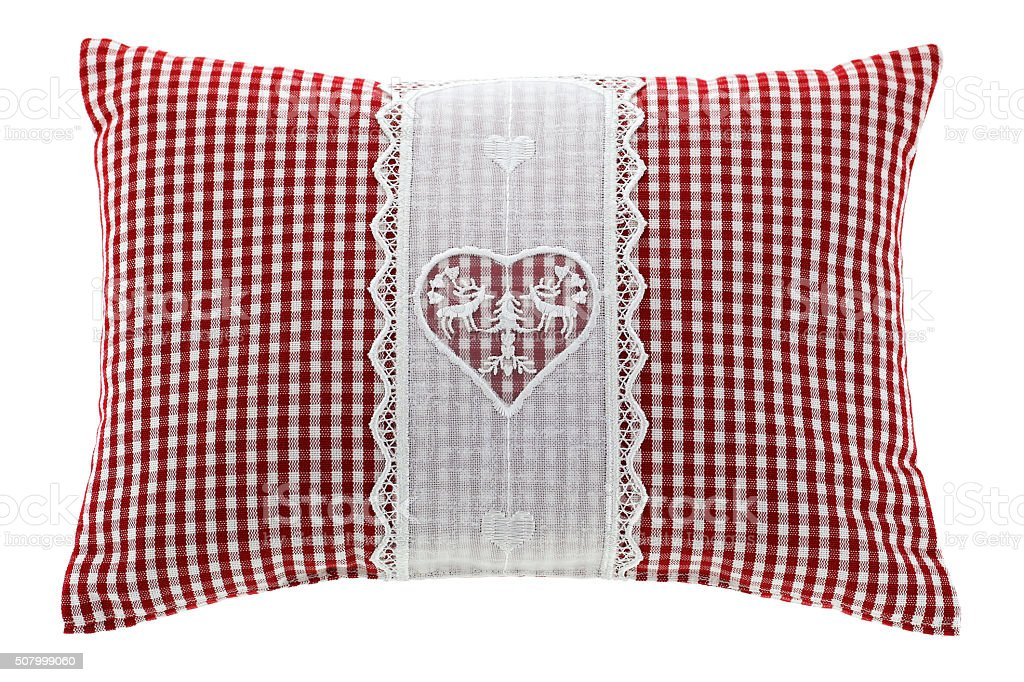 Red gingham pillow with flake of Swiss stone pine inside stock photo