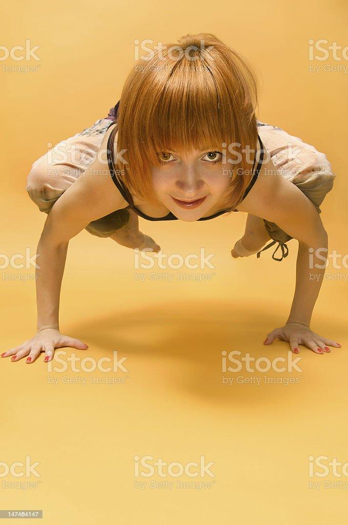 Red girl performing yoga asana stock photo