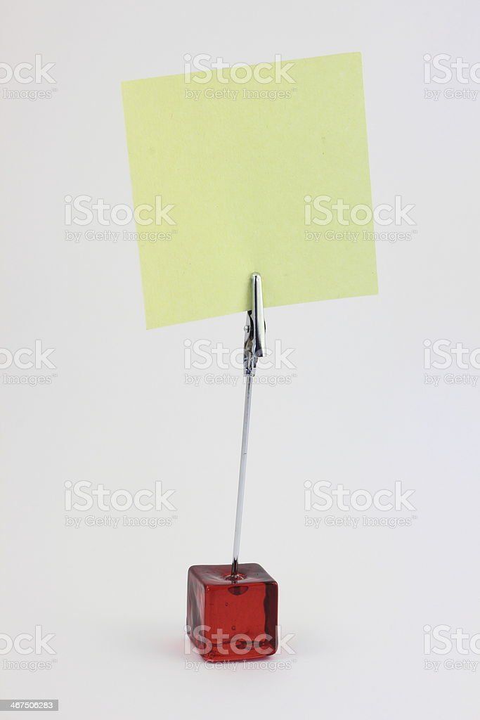 Red glass note-holder with alligator clip and blank yellow note stock photo