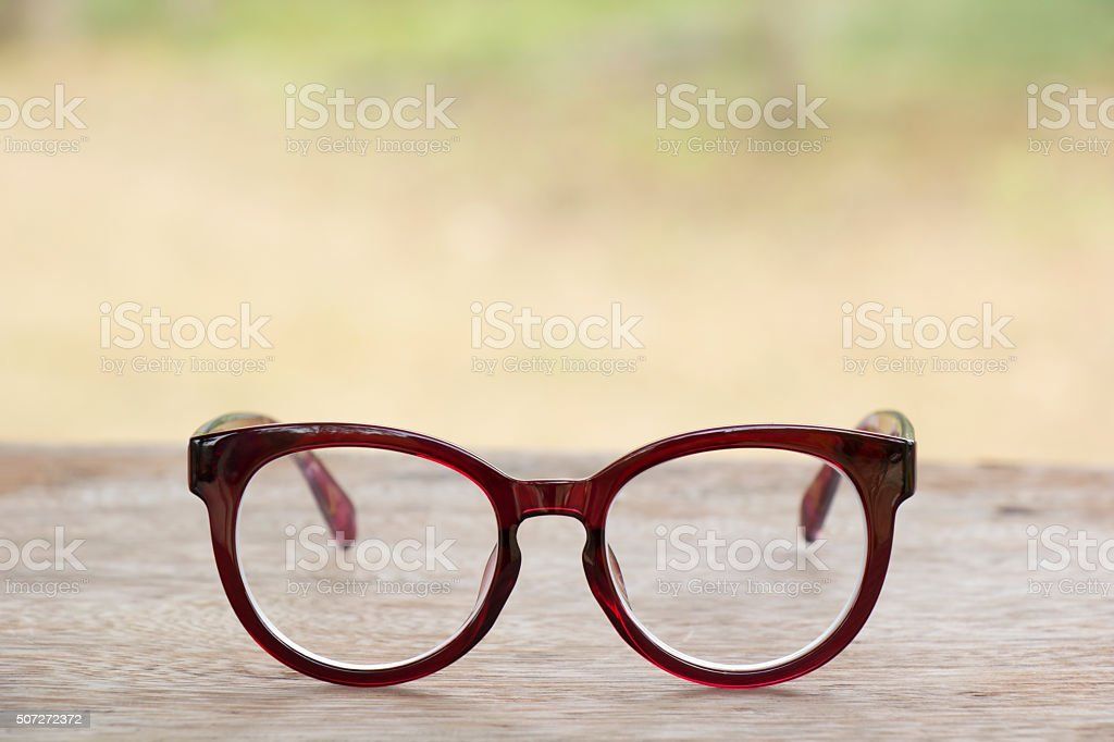 Red glasses on old  wood table stock photo