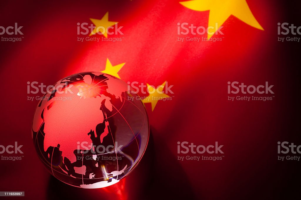 Red globe against Chinese flag stock photo