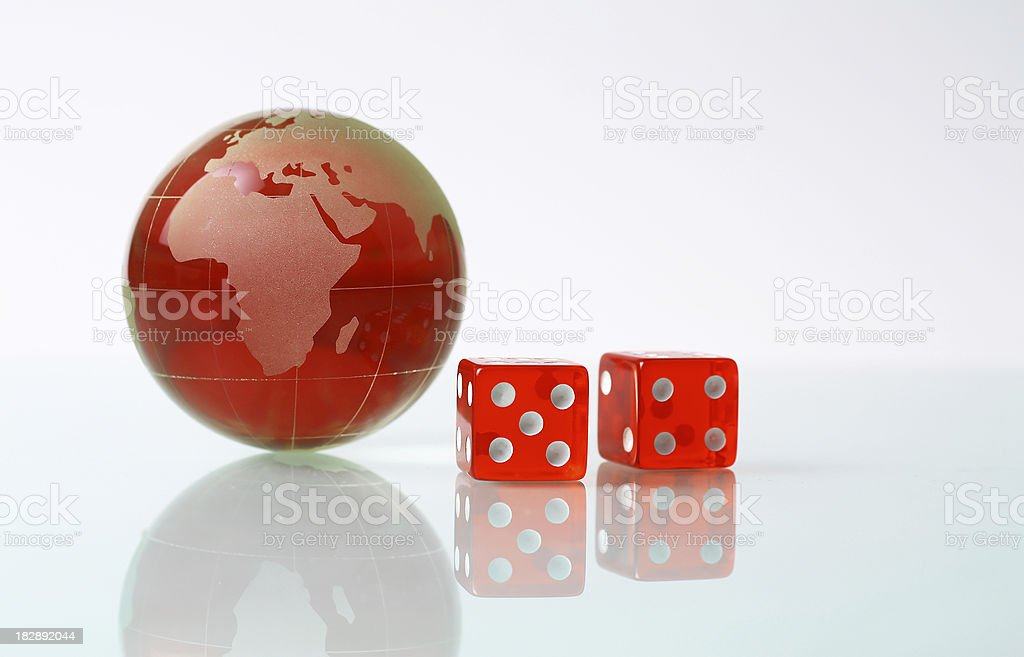Red globe and dices royalty-free stock photo